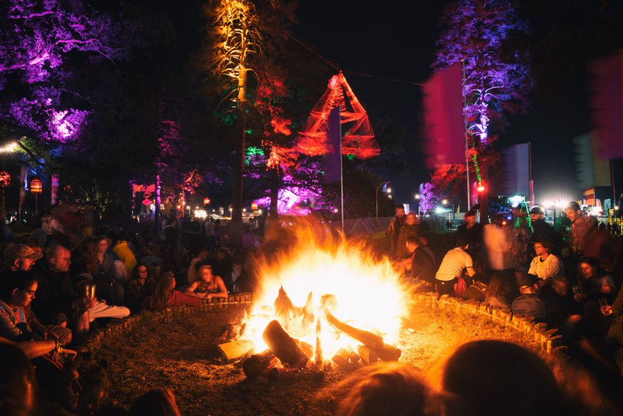 People sitting around a campfire at Electric Picnic